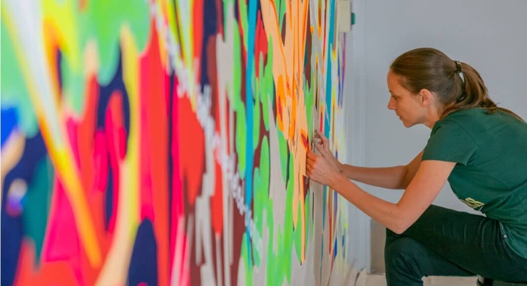 Claudia Chaseling prepares mutopia 2 painting, permanently on display inside the 310W office building.