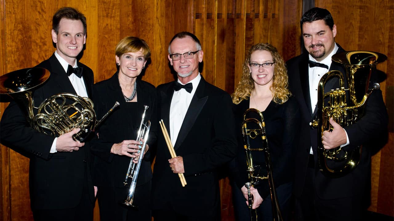 Eisenmann, left, with his family in the Waukesha Area Symphonic Band.