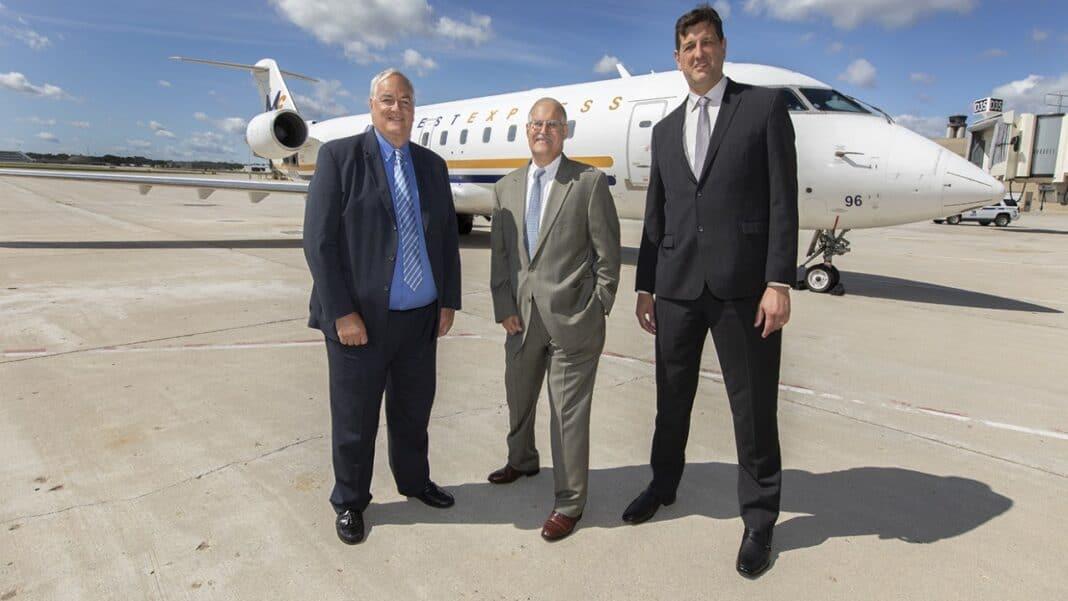 John Pearsall, president, Elite Airways; Greg Aretakis, president, Midwest Express; Brian Dranzik, airport director, Milwaukee Mitchell International Airport