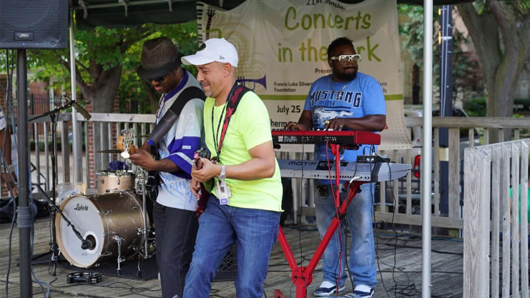 Dr. O'Rell Williams plays guitar during Concerts in the Park at Gengler Park.