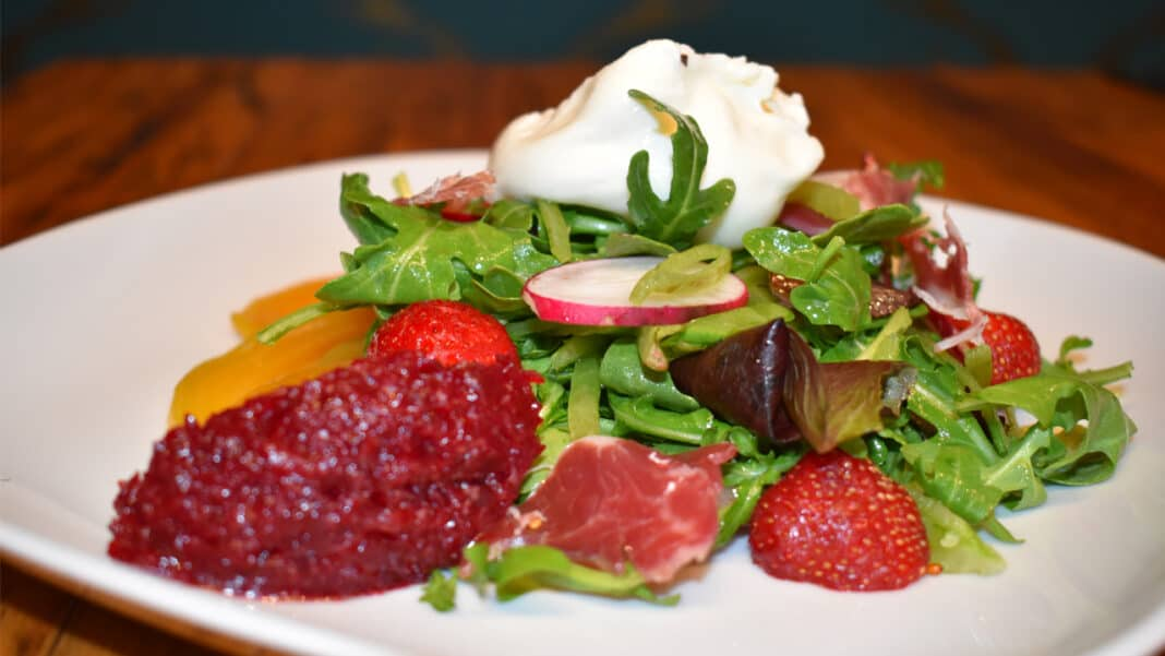 One of the more popular salads at Bavette La Boucherie is the Burrata Salad. It includes snap peas, radishes, strawberries, golden beets, golden beet relish, Spanish cured beef and burrata cheese. The salad incorporates some Spanish influences, with the addition of the cured beef.