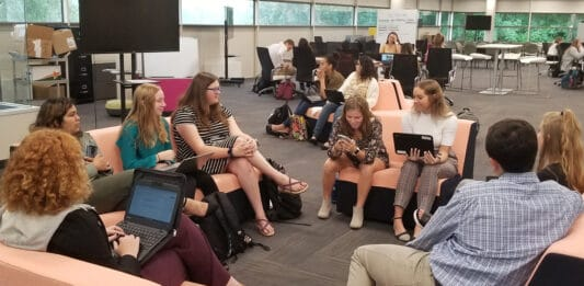 Students in the LAUNCH program work on real-world business projects and meet with clients in Concurrency's office in Brookfield.