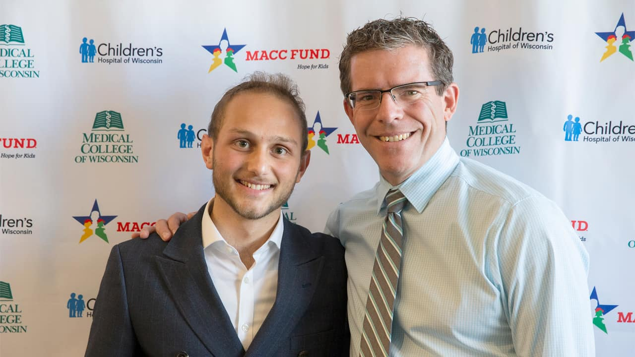 Raphael Ordan and Dr. Paul Harker-Murray at the announcement of the MACC Fund's $25 million commitment to pediatric cancer research at the Medical College of Wisconsin and Children's Hospital of Wisconsin.