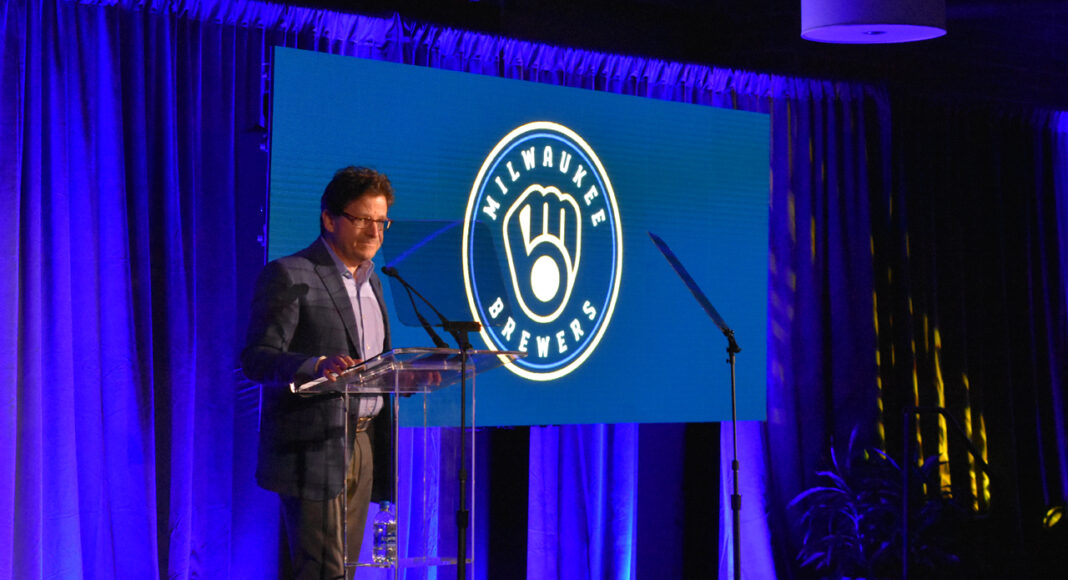 "Brewers principal owner Mark Attanasio unveils a redesigned version of the iconic ""Ball-in-Glove"" logo."