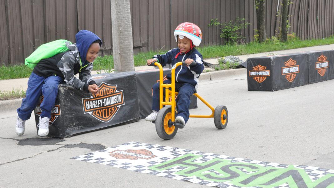 Children enjoy the Harley-Davidson Trike Track at the Walk for Children.