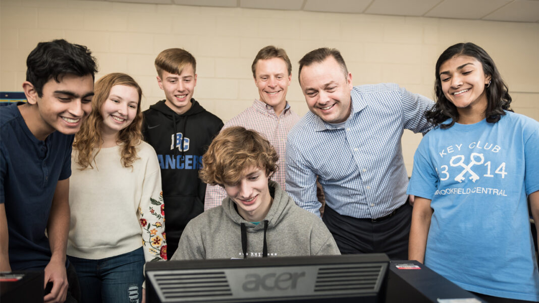 Brad Zepecki (second from right) and Brookfield Central High School teacher Ryan Osterberg (third from right) work with students Nabil Hussaini, Anja Logan, Aaron Melcher, Thomas Harmeyer and Rhea Ramachandran.